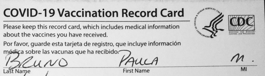 Top third of COVID vaccination record card from CDC
